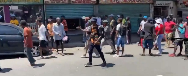 A screenshot of members of the MKMVA  forcefully shutting down all the foreign nationals shops in Durban on 3 November 2020. They demand them to leave the country immediately. Picture: @RiotAndAttackSA/Twitter