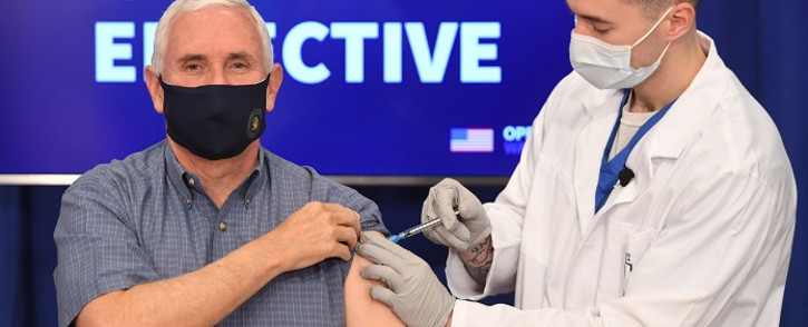 US Vice President Mike Pence receives the COVID-19 vaccine in the Eisenhower Executive Office Building in Washington, DC, on 18 December 2020. Picture: AFP.