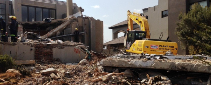 Seven people were killed and 11 others injured when a building caved in at the Meyersdal Eco Estate on 18 August 2014. Picture: Sebabatso Mosamo/EWN.