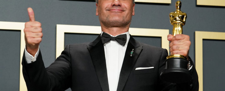 """FILE: Taika Waititi, winner of Best Adapted Screenplay for """"Jojo Rabbit,"""" poses in the press room during the 92nd Annual Academy Awards at Hollywood and Highland on 9 February 2020 in Hollywood, California. Picture: AFP"""
