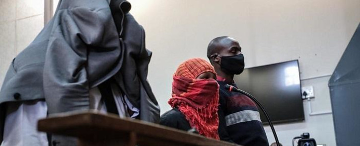 (From left to right) Simon Scorpion Nyalvane, Caylene Whiteboy and Voster Netshiongolo, the police officers accused of murdering Nathaniel Julies (16), appear in the Proteas Magistrates Court on 22 September 2020. Picture: Abigail Javier/EWN