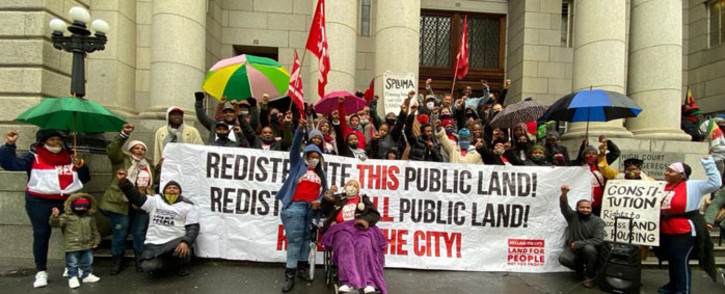 Activists celebrate on 31 August 2020 a Wester Cape High Court ruling setting aside the Wester Cape government's sale of the Tafelberg property in Sea Point to a private buyer. Picture: @NdifunaUkwazi/Twitter