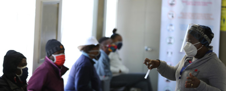 A medical worker addresses some of the first South African Oxford vaccine trialists waiting ahead of the clinical trial for a potential vaccine against COVID-19 at the Baragwanath hospital in Soweto on 24 June 2020. Picture: AFP