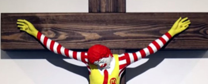 A YouTube screengrab shows the controversial McJesus sculpture.
