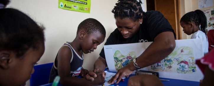 Reading aloud to a child is one of the most important things a parent and caregiver can do with children. Picture: @nalibaliSA/Twitter.
