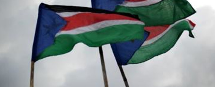 South Sudan flags fly in the sky.