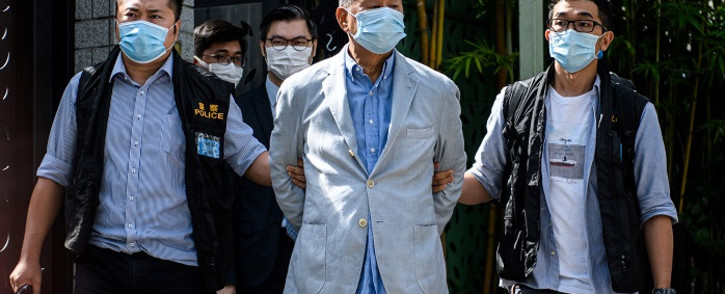 Police lead Hong kong pro-democracy media mogul Jimmy Lai (C), 72, away from his home after he was arrested under the new national security law in Hong kong on 10 August 2020. Picture: AFP