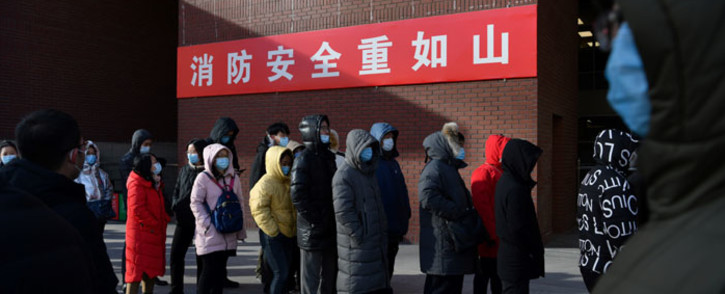 People line up to be tested for the COVID-19 coronavirus outside a hospital in Beijing, China, on 5 January 2021. Picture: AFP.