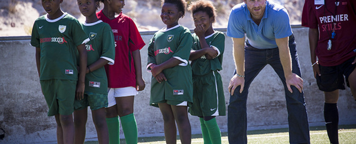 Prince Harry runs soccer drills with children at the Khayelitsha Football for Hope sports centre. Picture: Thomas Holder/EWN