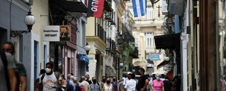 People walk along a street of Havana, on July 14, 2021. One person has died in the anti-government protests across Cuba, according to officials, with activists saying at least 100 people have been arrested and scores remain in detention as demonstrations overseas in solidarity continued. Picture: Yamil Lage / AFP