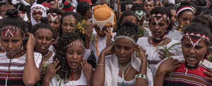 People from community of Oromo from different parts of Ethiopia celebrate Irreecha Afaan Oromo, also called Irreessa, a Thanksgiving holiday of the Oromo People in Ethiopia on September 30, 2018 in Bishoftu, Oromia. YONAS TADESSE / AFP