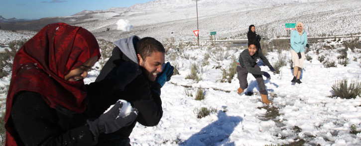 A couple duck to avoid being hit by a snow ball as friends get into a snowball fight. Cere in the boland has been transformed into winter wonderland after winter snowfall. Picture: Bertram Malgas
