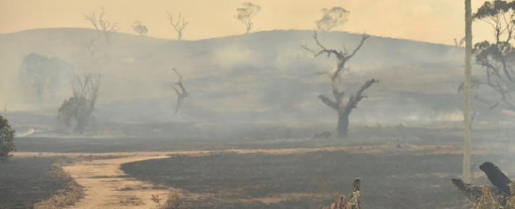 A bushfire burns near the town of Bumbalong, south of Canberra on 2 February 2020. A fire that threatened Canberra's southern suburbs was downgraded early on 2 February, allowing firefighters to strengthen containment lines and protect residents. Picture: AFP