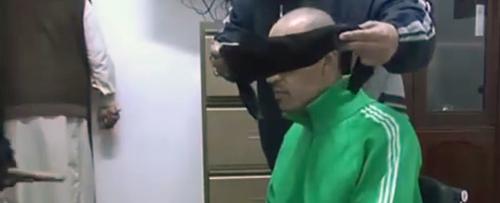 A screengrab from a video which purportedly shows Saadi Gaddafi being blindfolded and beaten by guards.