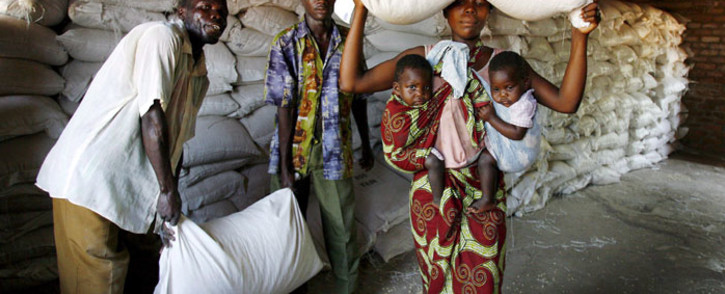 A local mother of twins collects her family's monthly food aid ration from a United Nations World Food Programme. Picture: EPA/Jon Hrusa.