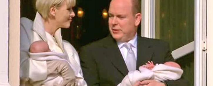 Monaco's royal couple Prince Albert and Princess Charlene present their new twin babies to the people of Monaco. Picture: Twitter @PrincipadoMonac