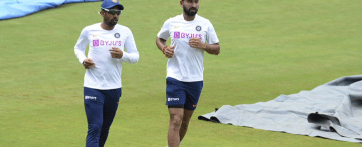 FILE: Indian cricketers Wriddhiman Saha (L) and Cheteshwar Pujara run during a practice session ahead of the first test match between India and South Africa at the Dr. Y.S. Rajasekhara Reddy ACA-VDCA Cricket Stadium in Visakhapatnam on 30 September 2019. Picture: AFP