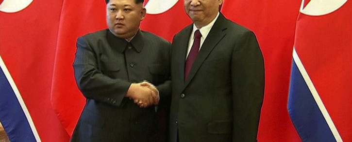 FILE: Chinese President Xi Jinping and North Korean leader Kim Jong Un shaking hands during their meeting in Beijing on 27 March 2018. Picture: AFP