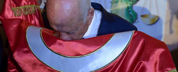 Conservative academic Kais Saied kisses the Tunisian flag as he celebrates his victory in the Tunisian presidential election in the capital Tunis on 13 October 2019. Picture: AFP