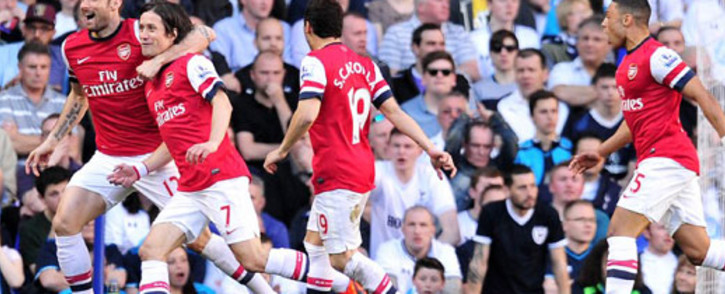 Arsenal's Czech midfielder Tomas Rosicky (2nd L) celebrates after scoring his team's first goal during the English Premier League football match between Tottenham Hotspur and Arsenal at White Hart Lane in north London on 16 March 2014. Picture: AFP.