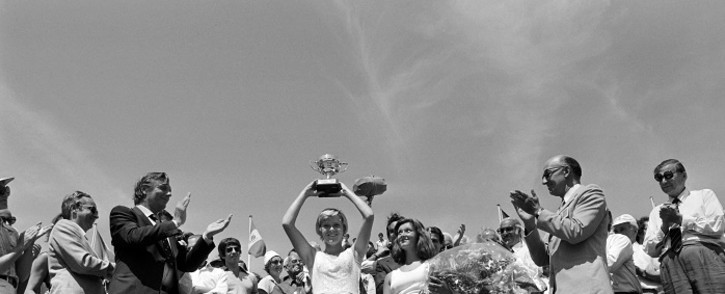 FILE: British Sue Barker holds up her trophy after defeating Czech Renata Tomanova at Roland Garros stadium during the French tennis Open, on 13 June 1976. It was Barker's 1st (and only) career Grand Slam title. Picture: AFP