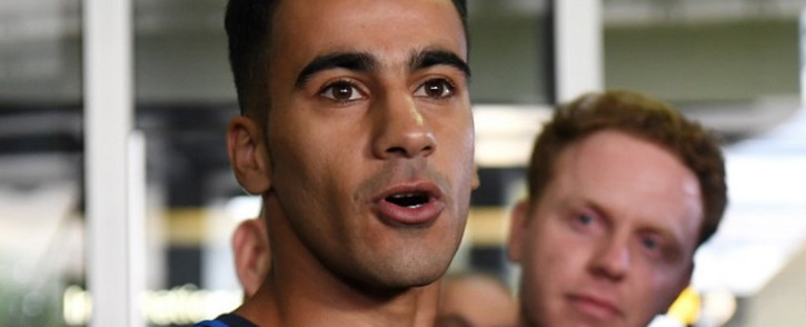Footballer Hakeem al-Araibi (L) speaks to the media upon his arrival at the airport in Melbourne on 12 February 2019. Picture: AFP
