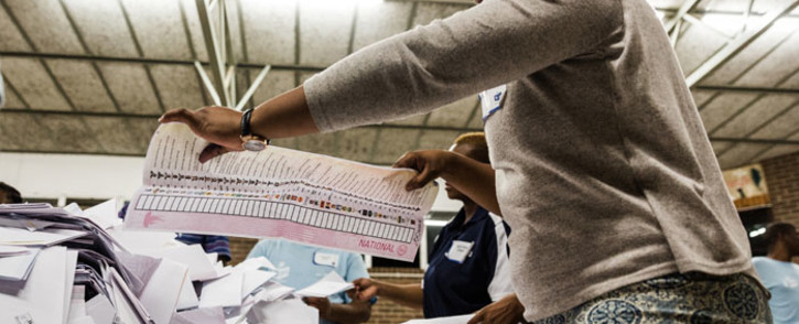 An IEC electoral officer counts ballot papers at the Addington Primary School after voting ended in the sixth national general elections in Durban on 8 May 2019. Picture: AFP