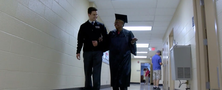 A screengrab of Annie Dillard (92) on her way to her graduation.