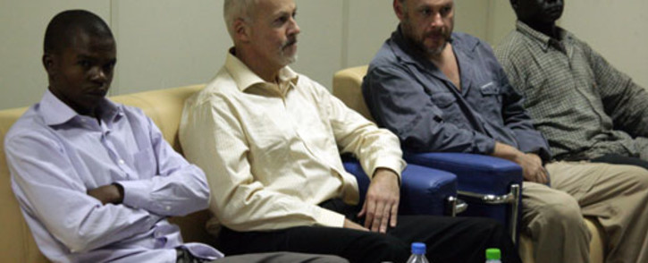 The four men who were arrested by Sudanese officials look on during a press conference by the Sudanese Defense Minister former South African president Thabo Mbeki on May 20, 2012. Picture: AFP