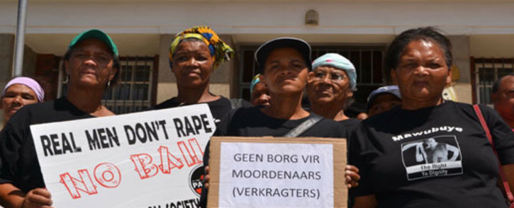 Women protested outside the Bredasdorp Magistrate's Court on 26 February 2012, where a man accused of raping and murdering Anene Booysen appeared.  Picture: Renee de Villiers/EWN