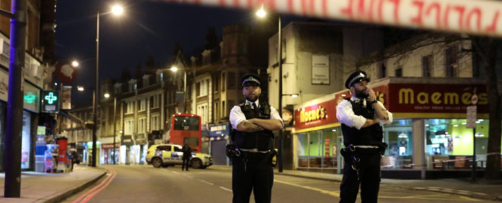 Police officers guard a cordon, set up on Streatham High Road, at the junction of Prentis Road, in south London on 2 February 2020, after a man is shot dead by police following reports of people being stabbed in the street. Picture: AFP