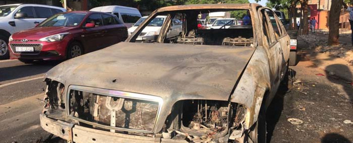 The remains of a metered taxi which was torched in Arcadia in Pretoria on 2 March 2018. Picture: Christa Eybers/EWN.