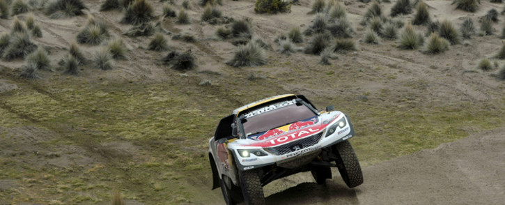 Peugeot's driver Stephane Peterhansel and his co-driver Jean Paul Cottret of France compete during the Stage 7 of the Dakar 2017 between La Paz and Uyuni, Bolivia, on 9 January, 2017. Picture: AFP.