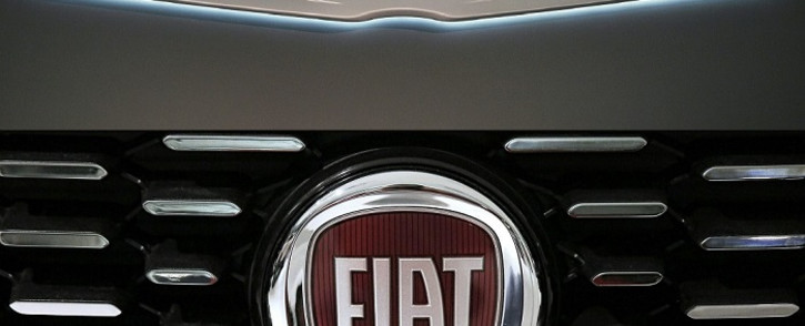 This combination of file pictures created on 31 October 2019, shows a Chrysler logo seen at the 2016 Washington Auto Show on 27 January 2015 in Washington, DC and a picture of the logo of Italian automaker Fiat on 12 January 2017 in Saluzzo, near Turin. Picture: AFP
