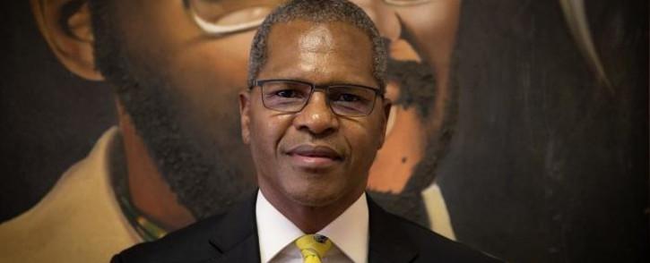 Velenkosini Hlabisa looks on at Mangosuthu Buthelezi portrait at the IFP's offices in Ulundi, KwaZulu-Natal. Picture: Xanderleigh Dookey/EWN