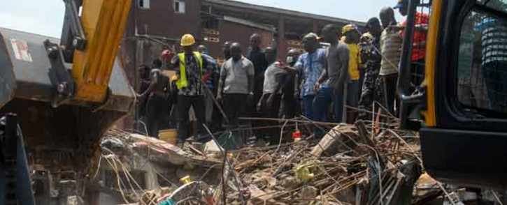 FILE: Emergency and rescue personnel are seen at the site of a building which collapsed in Lagos on 13 March 2019.  Picture: AFP