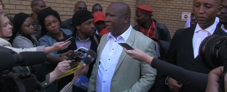 FILE: EFF leader Julius Malema addressed the media outside the North Gauteng High Court in Pretoria on 25 August 2014 after his provisional sequestration case was postponed to 1 December. Picture: Reinart Toerien/EWN