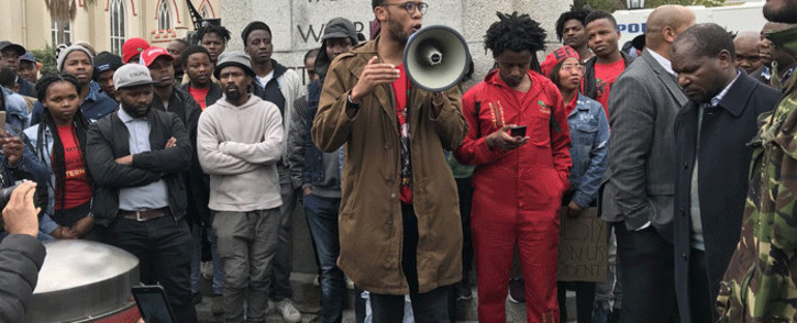 Students outside Parliament want government to respond to their call for amnesty for those arrested during the Fees Must Fall protests. Picture: Kaylynn Palm/EWN.