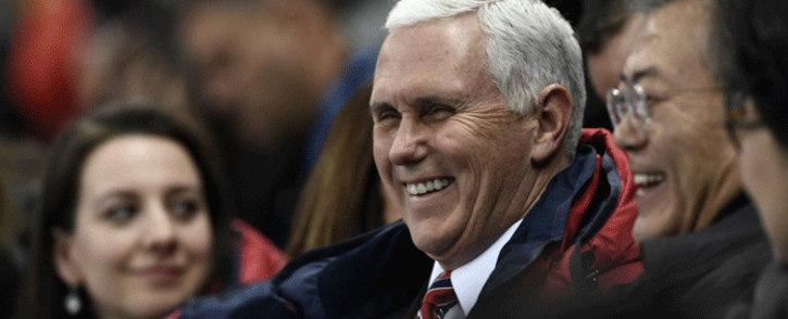 US Vice President Mike Pence talks to South Korea's President Moon Jae-in during the short track speed skating event during the Pyeongchang 2018 Winter Olympic Games, at the Gangneung Ice Arena in Gangneung on 10 February, 2018. Picture: AFP.