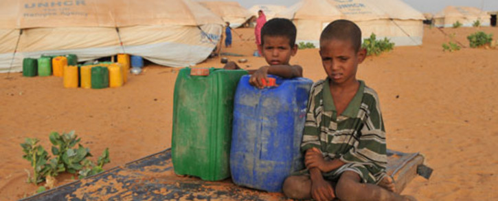 Malian refugee boys hold buckets of water in the refugee camp of M'bere near Bassikno, south east of Mauritania. Picture: AFP