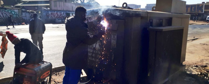 City Power workers weld up an electricity power box to prevent access to cable thieves and vandals. Picture: @JoburgMPD/Twitter