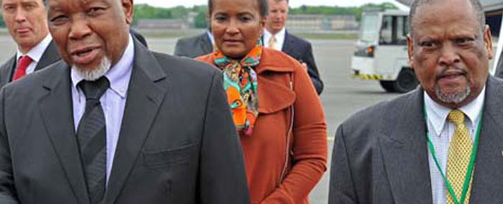 """""""Deputy President Kgalema Motlanthe (L) is pictured with Makhenkesi Stofile (R) at Tegel Airport, Berlin, Germany in 2012. Picture: Elmond Jiyane/GCIS."""