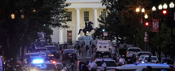 A large law enforcement response is seen near the White House after a protest was dispersed on June 1, 2020 in downtown Washington, DC. Protests and riots continue in cities across America following the death of George Floyd, who died after being restrained by Minneapolis police officer Derek Chauvin. Picture: AFP.