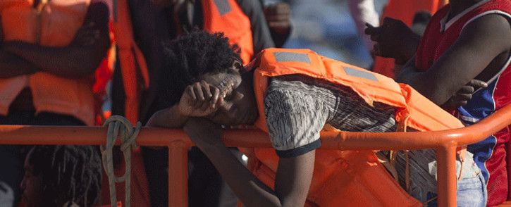 FILE: A Spanish coast guard boat with migrants onboard arrives at Malaga's harbour on 23 September 2018, after an inflatable boat carrying 117 immigrants, 34 of them women and 4 children, was rescued by the Spanish coast guard off the Spanish coast. Picture: AFP