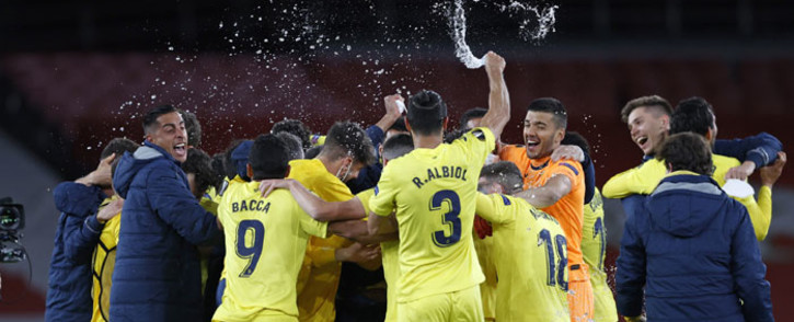 Villarreal players celebrate on the final whistle in the UEFA Europa League semifinal, 2nd leg football match between Arsenal and Villarreal at the Emirates Stadium in London on 6 May 2021. The game finished 0-0, Villarreal winning the tie 2-1 on aggregate. Picture: Adrian Dennis/AFP
