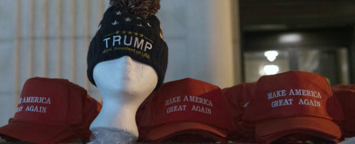 Hats are displayed for sale on the morning of Donald Trump's inauguration as the 45th President of the United States. Picture: AFP.