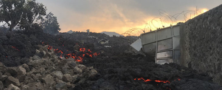 Smoldering ashes are seen early morning in Goma in the East of the Democratic Republic of Congo on 23 May 2021 following the eruption of Mount Nyiragongo. Picture: Moses Sawasawa/AFP