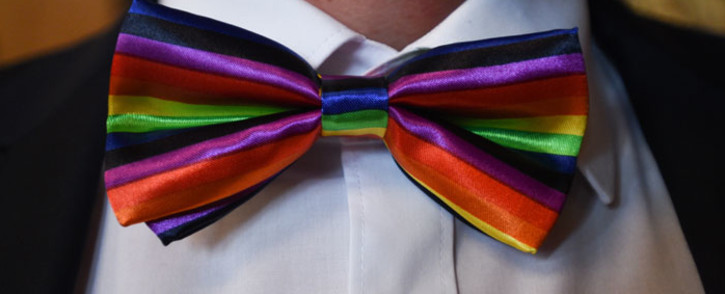 A guest wears a rainbow coloured bow-tie during a same-sex wedding in Hamburg, northern Germany on 1 October 2017. Germany celebrated its first gay marriages as same-sex unions became legal after decades of struggle.. Picture: AFP
