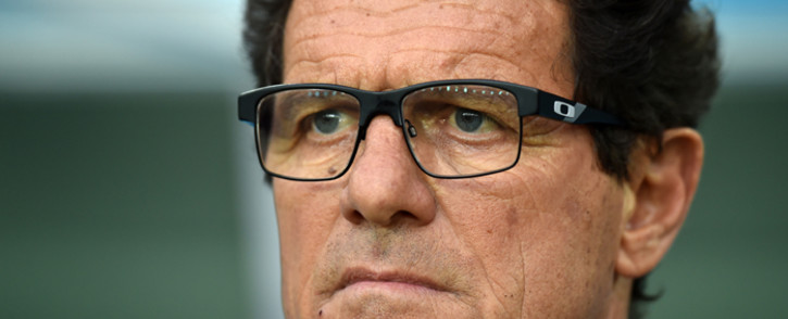 Russia's Italian coach Fabio Capello reacts during a Group H football match between Algeria and Russia at the Baixada Arena in Curitiba during the 2014 FIFA World Cup on 26 June, 2014. Picture: AFP.