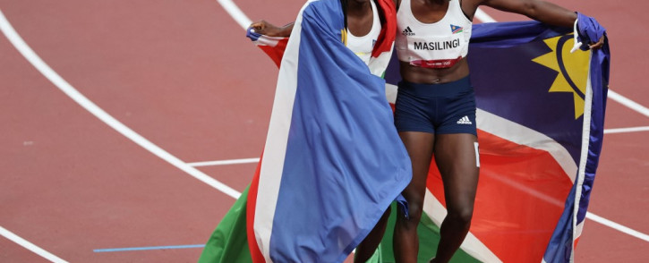 Namibia's Christine Mboma (L) celebrates with Namibia's Beatrice Masilingi after taking silver in the women's 200m final during the Tokyo 2020 Olympic Games at the Olympic Stadium in Tokyo on 3 August 2021. Picture: Giuseppe Cacace/AFP